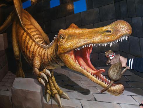 恐竜に食べられそうになるフェレット